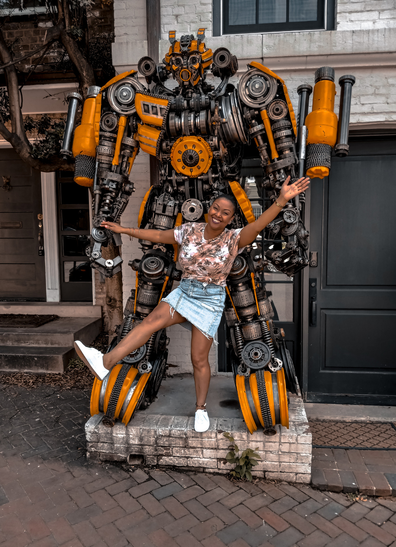 Blogger Rogan Smith smiles and poses in front of the Bumblebee Transformer in Georgetown, DC
