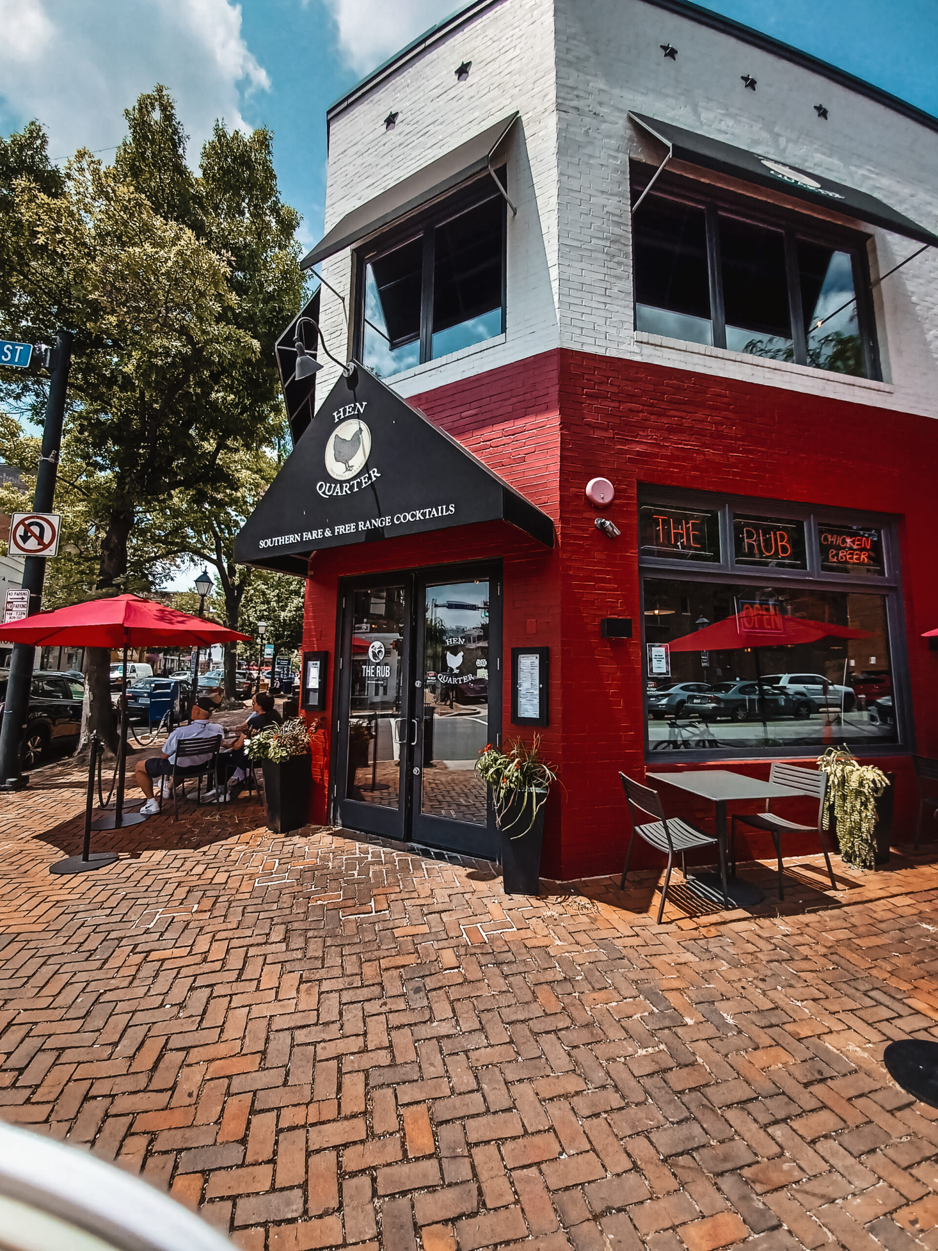Photo of Hen Quarter restaurant in Alexandria Virginia. The building is red and white and black.