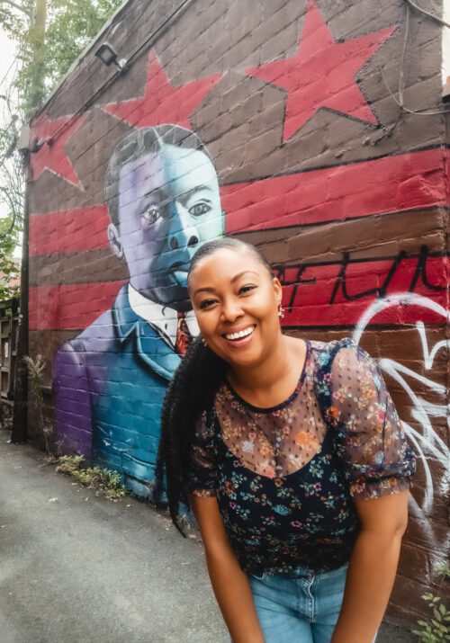 This Bahamian Gyal blogger Rogan Smith poses in front of the Paul Laurence Dunbar mural in Washington DC