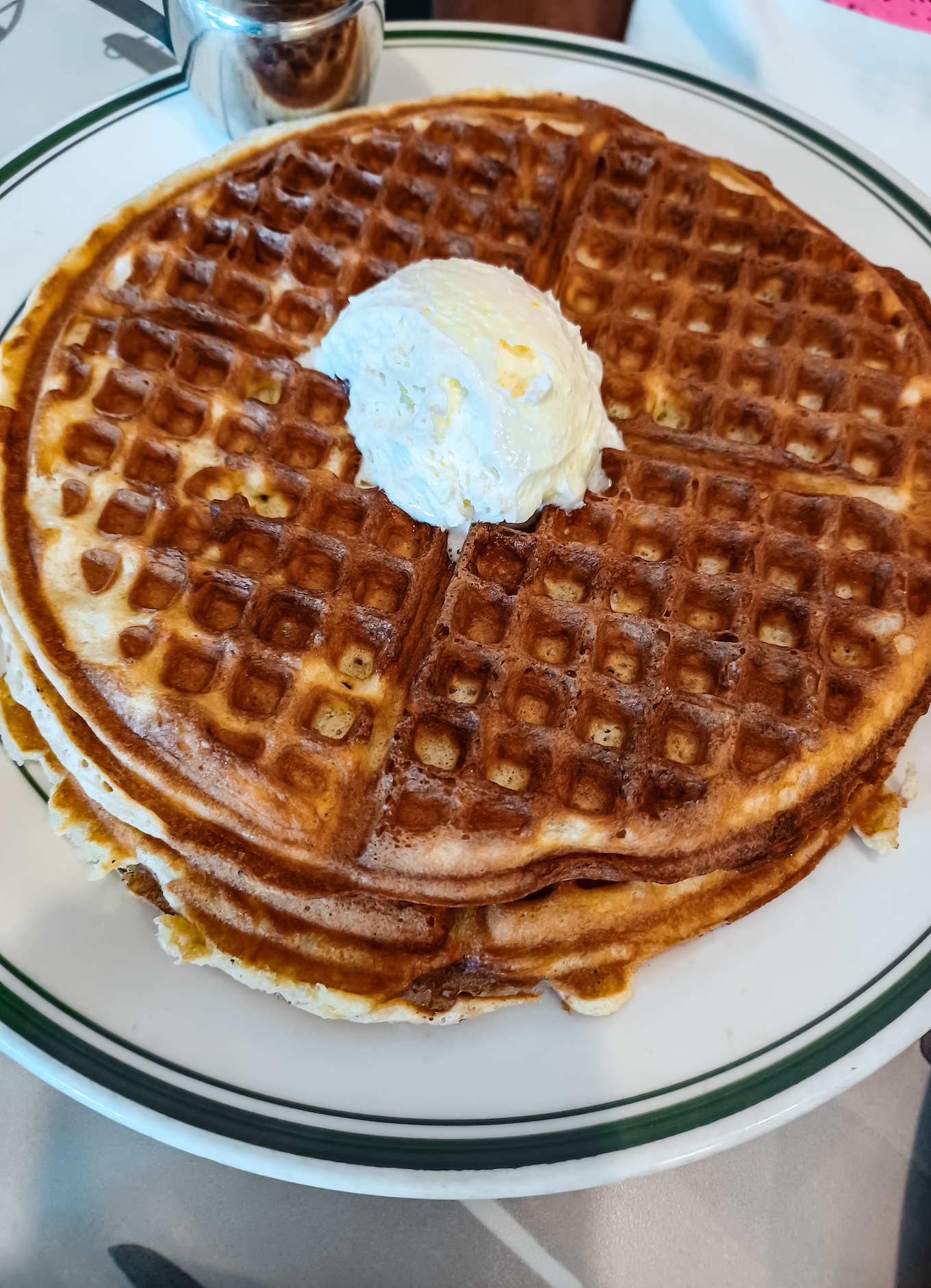 a plate of waffles with butter on top from ari's diner in washington dc