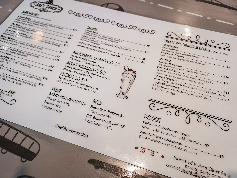 ari's diner menu on a table