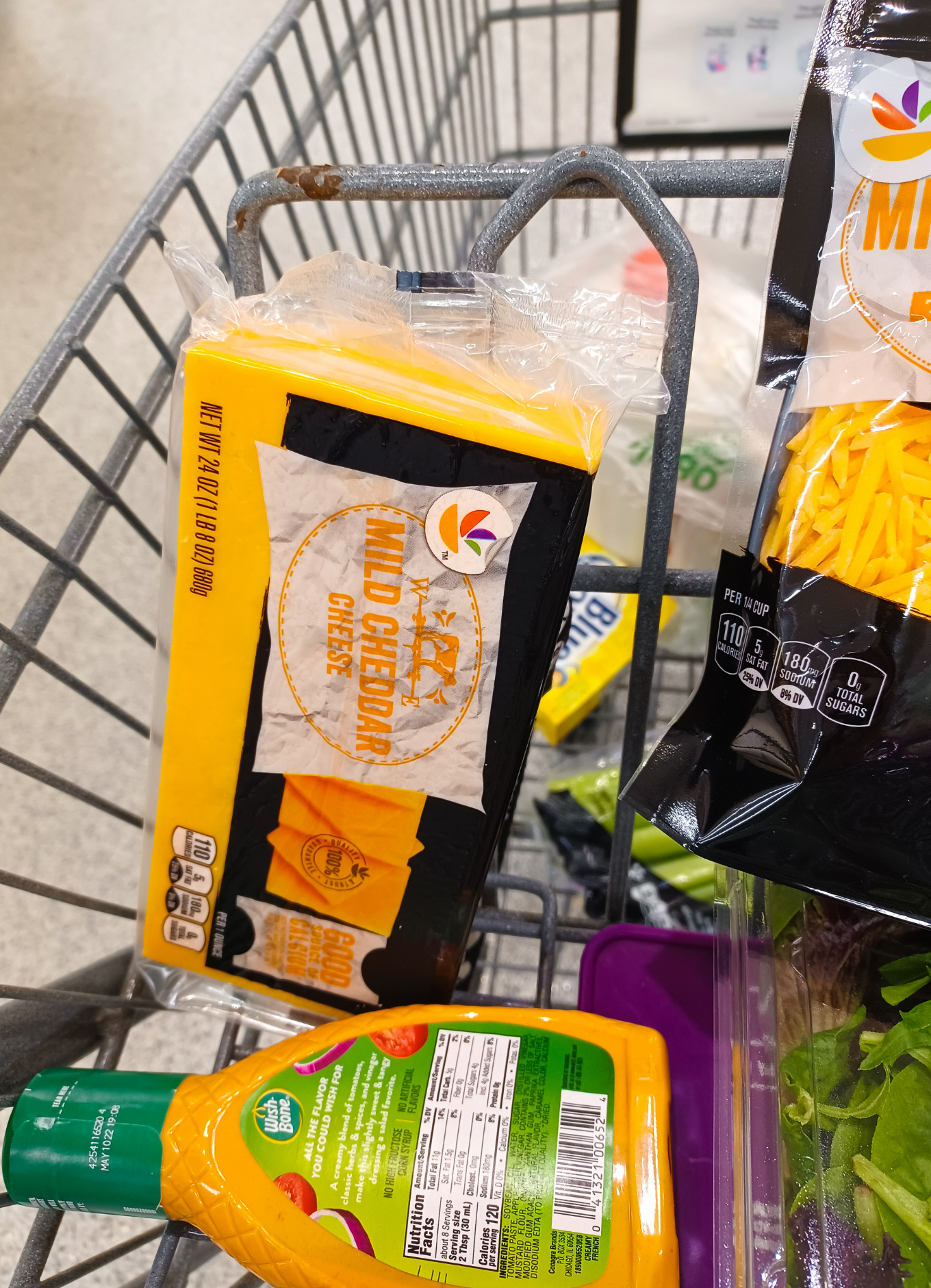 A grocery cart of mild cheddar cheese