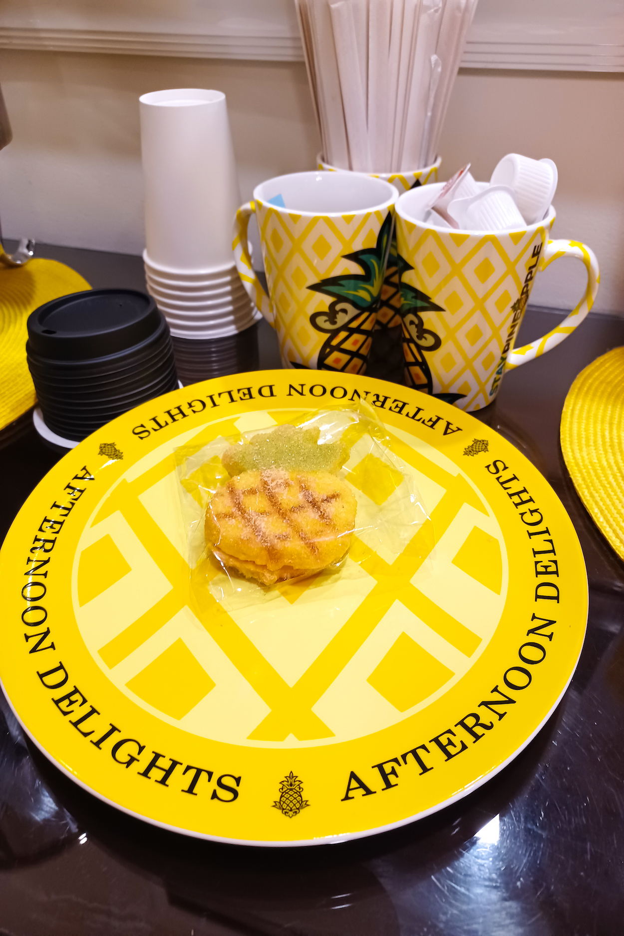 A pineapple shaped sugar cookie sits on a plate at StayPineapple Hotel New York City