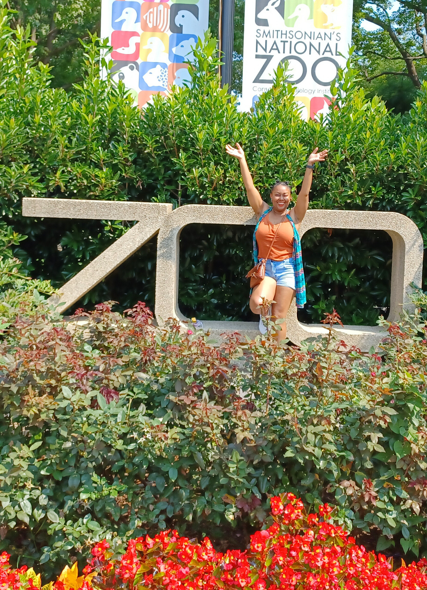 This Bahamian Gyal blogger, Rogan Smith smiles in front of the Smithsonian National Zoo in Washington DC