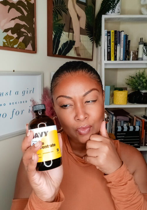 Washington DC blogger Rogan Smith holds a bottle of Javy coffee concentrate in her hand