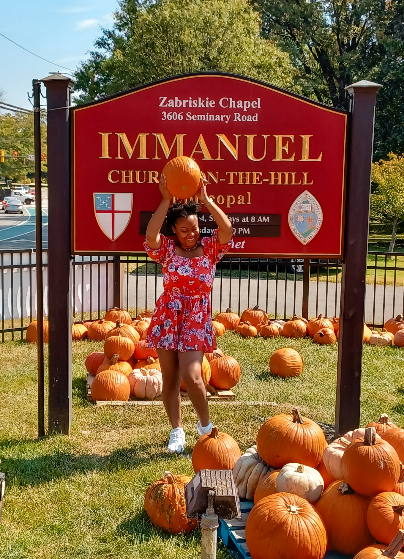 Washington DC-based blogger, Rogan poses while holding a pumpkin above her head.
