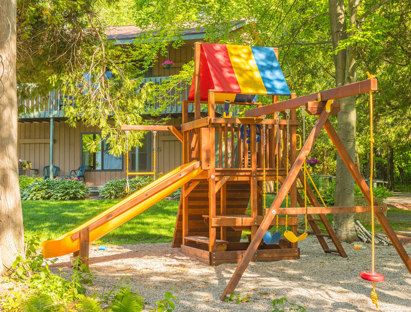 Playground surrounded by trees at the Shallows Resort