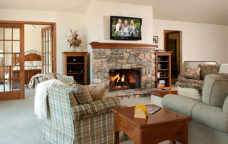 West Ridge open living room and dining room with gas fireplace