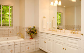 West Ridge master bath with a whirlpool tub and shower