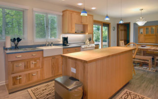 Falun House full kitchen with a refrigerator, dishwasher, range, and microwave