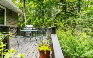Bluffside's deck with small table and chairs