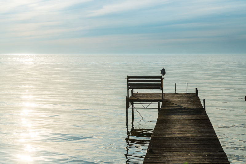 Wooden pier extending out into bay
