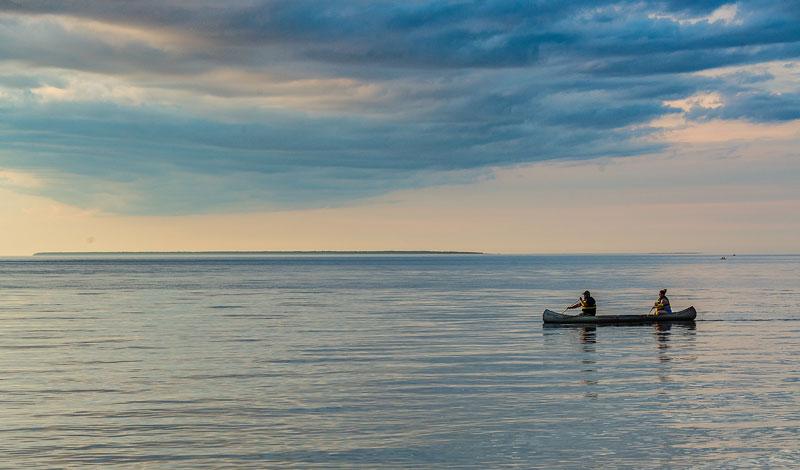 People canoeing across the bay