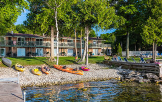 Kayaks on the water in front of the Shoreside Motel