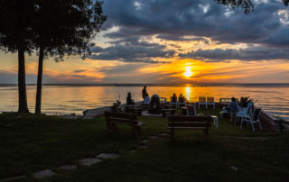 People watching the sunset from patio by Shoreside Motel