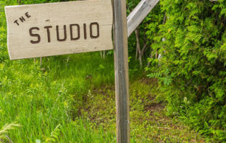 Wooden sign for the Studio