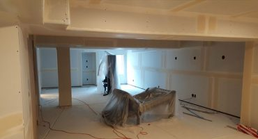 Drywall Installation in Progress by Remodeling Contractors