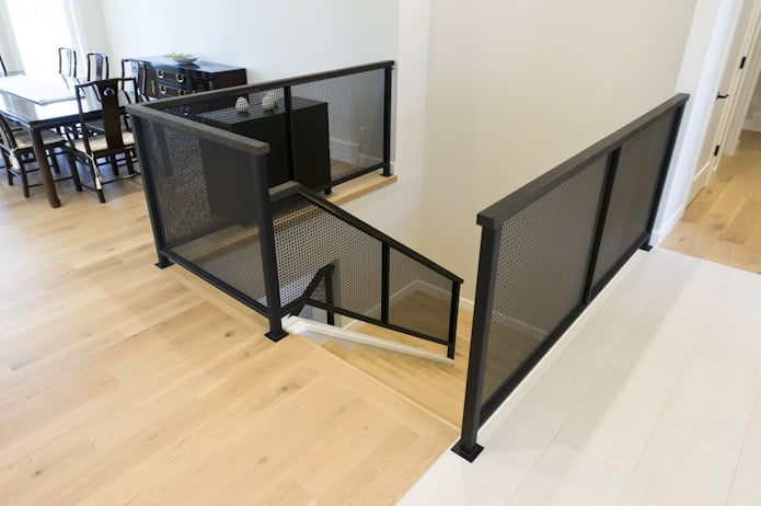 perforated-steel-stair-case-oxidized-oak-hand-rail