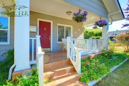 front porch with red door