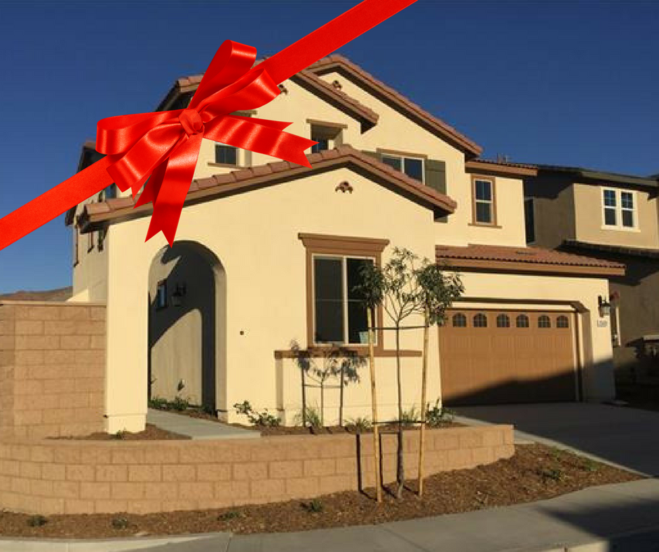 Front view of a new construction home with a bow on it