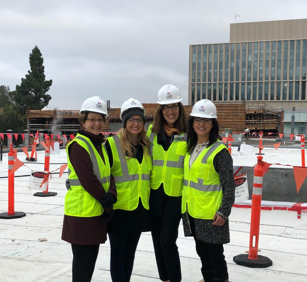 The project team touring the new space