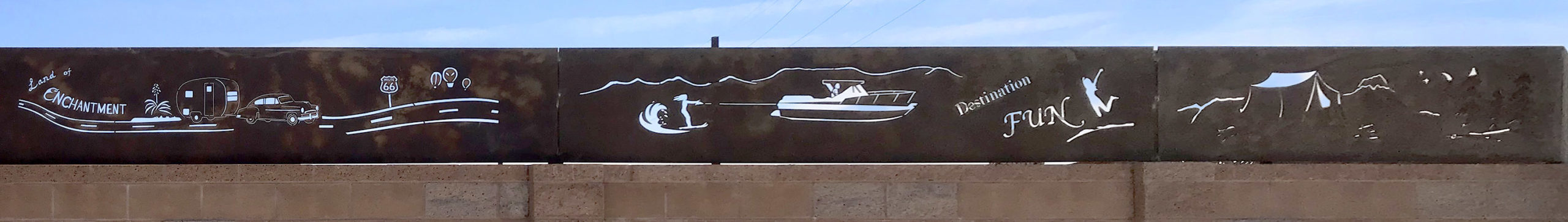 Whimsical adventure-themed cutout on our exterior wall