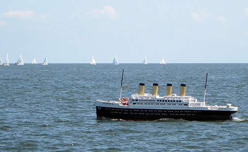 A miniature cruise ship was one of many boats out on the lake today.