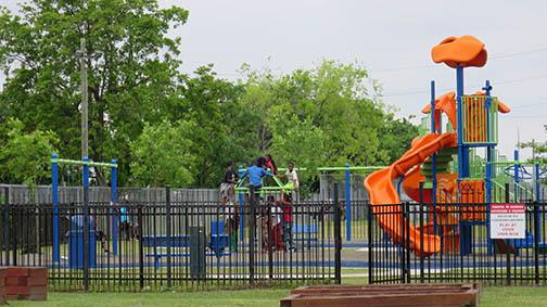 Children enjoying the playground at 2200 Lafitte Street in New Orleans.