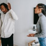 unhappy young black couple discussing relationships at home