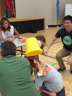 Students and families play a literacy game.