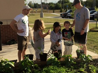 Week 8. The CASP staff and the Garden Your Own Growth team watch on as students water the garden and take responsibility for their food.
