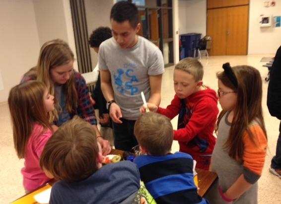 Washington CASP staff help the kiddos make their guac!