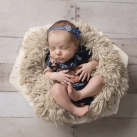 Newborn photography - baby girl in floral romper & wood bowl