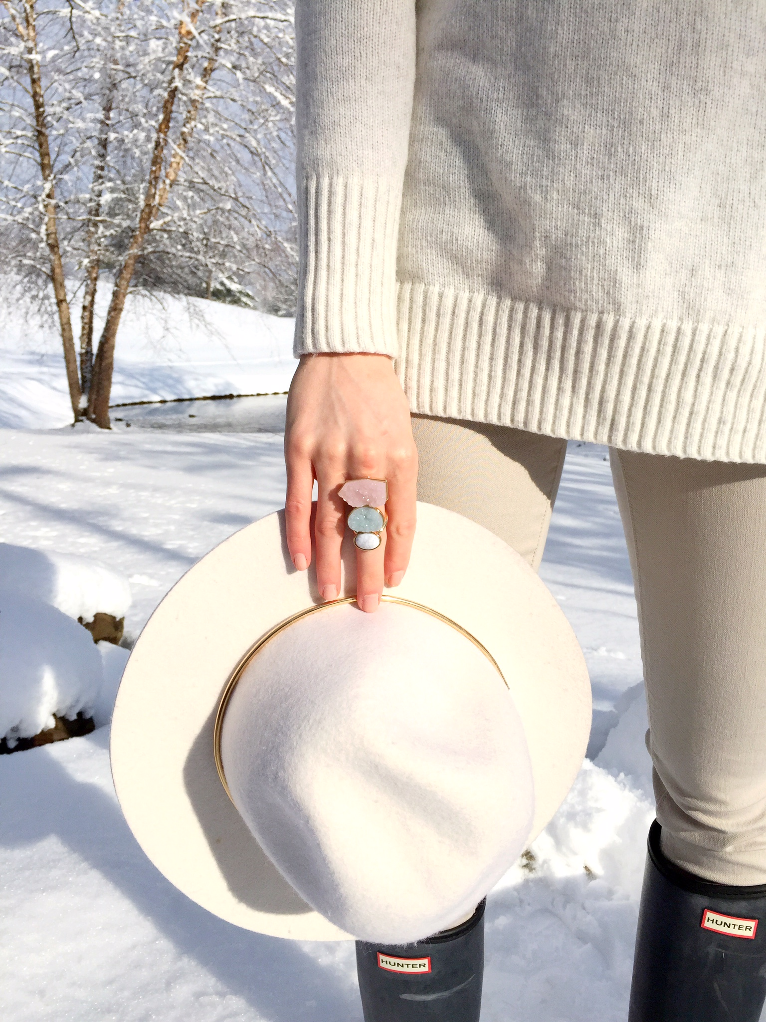 crystal marble and gold ring   floppy hat   hunter boots   winter white outfit idea