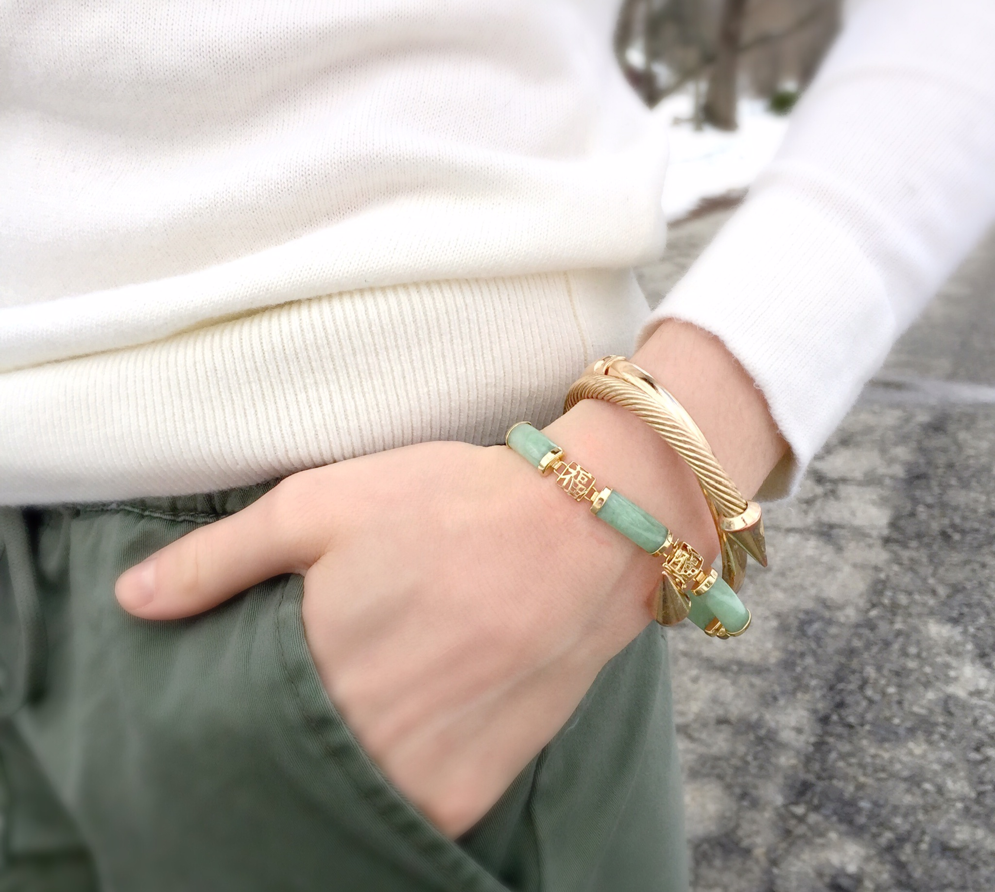 jade and gold arm party   stacked bracelets