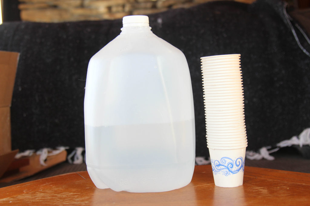 Water and paper cups to dispense medicines