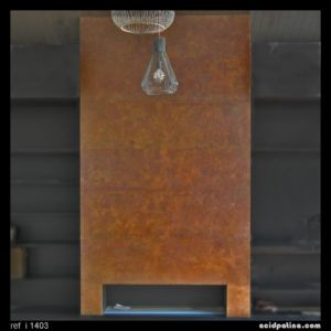 Copper-clad fireplace with a bronze patina. This custom made copper wall provides a unique interior decor feature.