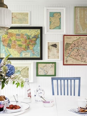 eclectic map gallery wall