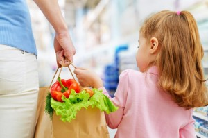 mom and child grocery shopping