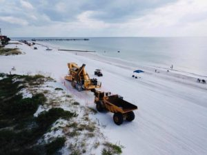 redington shores beach with utility trucks