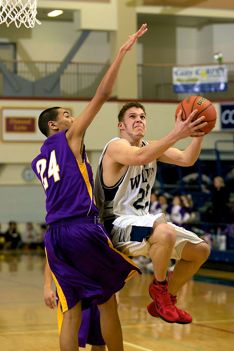 Senior Dom Young draws a foul on a shot attempt against Lathrop