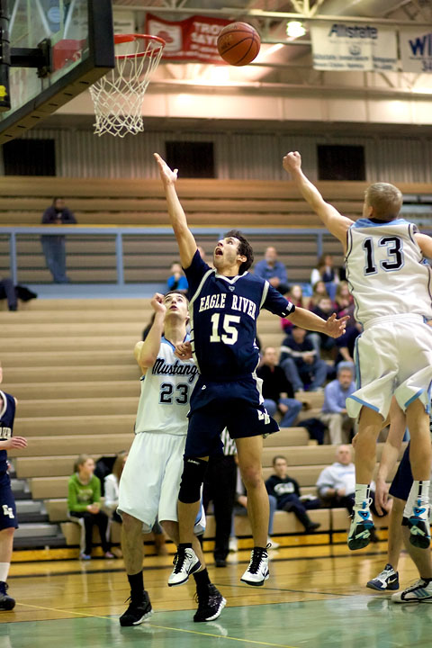 Senior Nate Yaw floats a shot up in the second half against Chugiak