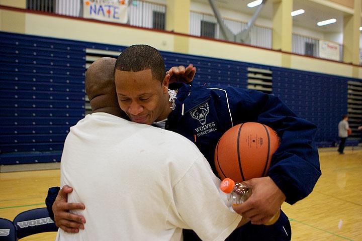 Coach Bowyer and Varsity Coach Craig Harrison hug after Coach Bowyers' last game as JV coach