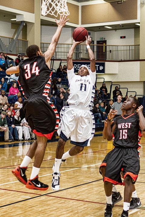 Junior Shaquan Rhoades shoots over the West Defense