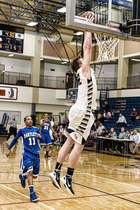 Senior Kevin Waterman goes up for his last Dunk in the Wolves Den