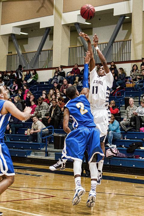 Junior Shaquan Rhoades shoots over the Bartlett defense Wednesday night