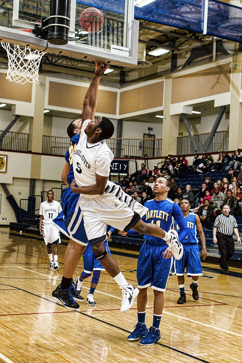 Senior Chris Parker cuts baseline for a backboard slapping lay-up