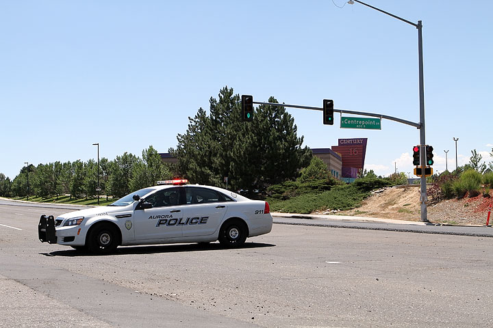 Police keep people away from the Century 16 theater in Aurora, CO, just outside Denver after a shooting at the Midnight Premier of the Dark Knight Rises where 12 people are confirmed dead and many more injured