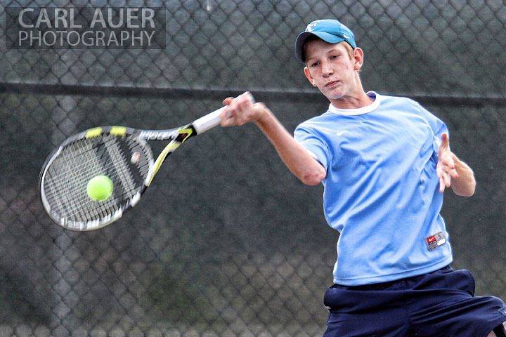 September 11, 2012:  A Ralston Valley Varsity Tennis player returns the ball in his match against Dakota Ridge