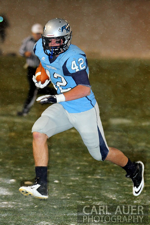 October 25th, 2012: A Ralston Valley full back runs with the ball against Legacy High School defense on Thursday night in the snow and cold.